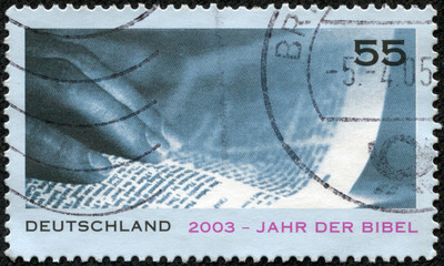 stamp printed in German showsHand and Page