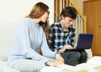 couple with laptop preparing for exam
