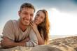 happy couple sand