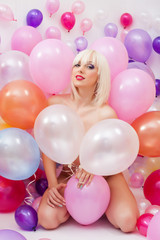 Sexy platinum blonde posing with balloons