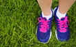 Sport Footwear on Female Feet on Green Grass. Closeup Running