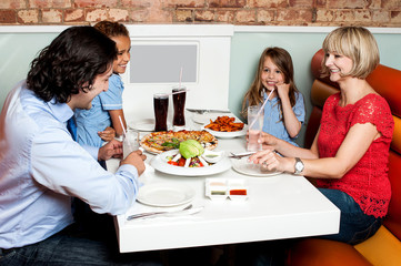Happy family enjoying dinner