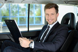 Fototapety Businessman In The Car