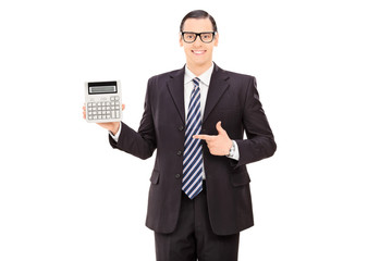 Businessman pointing towards a calculator
