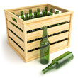 Wooden box with empty beer bottles.