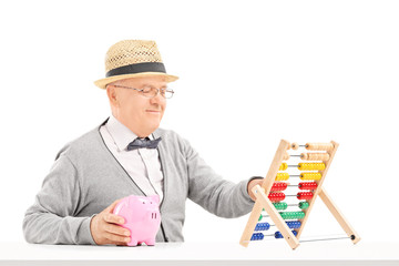 Senior gentleman counting on abacus