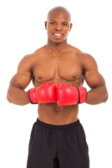 african muscular man with boxing gloves
