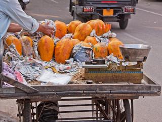 Mango seller's cart parked at a roadside in Jaipur