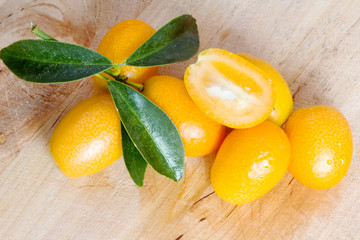 kumquat over wooden background