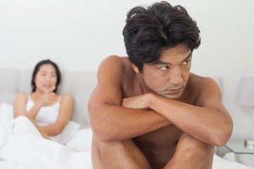 Couple not talking after argument in bed