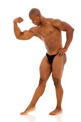 afro american bodybuilder flexing muscles