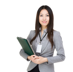 Asian businesswoman with file pad and laptop