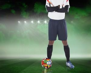 Goalkeeper standing with international ball