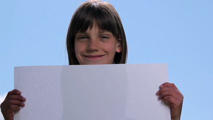 Boy holding a sheet of paper.Child holding a sheet of paper