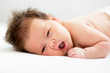 adorable newborn baby lying on stomach