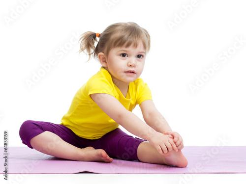 Leinwanddruck Bild Kid girl doing fitness exercises