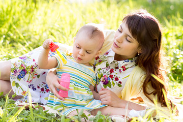 mother and baby girl having fun outdoors