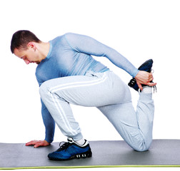 Sports man stretching over white background