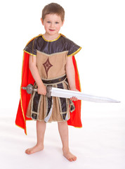 little boy dressed as a knight.