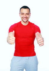 Sportive man thumbing up in red T-shirt over white background