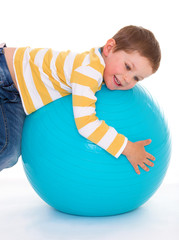 little boy with a big ball.