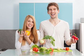 Young beautiful couple cooking at home