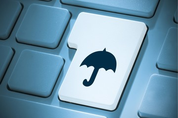 Composite image of umbrella on enter key