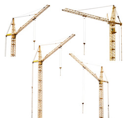 set of four yellow hoisting cranes isolate on white