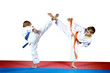 High kicks legs athletes are training on the red and blue mat - 64854720