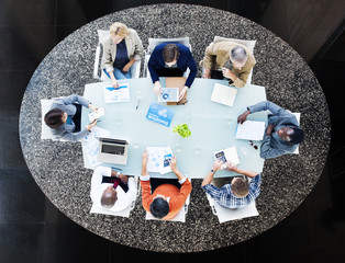Group of Business People Discussing in a Meeting