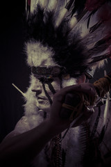 American Indian chief with big feather headdress, warrior