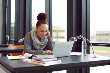 University student studying using laptop