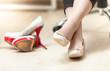 photo of woman wearing ballet flats instead of high heels