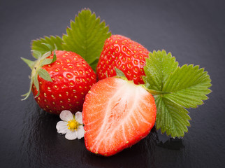 Fresh strawberries on a slate