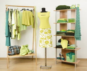 Dressing with neon green clothes on hangers, shelf and mannequin