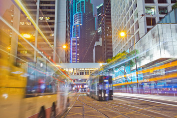 tram and bus on the road the night of Hong Kong