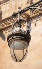 Old forged lantern in the street in Barcelona