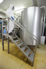 Technician controlling industrial process
