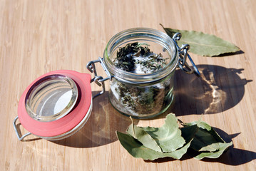 Dry herbs with salt and laurel