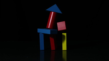 Building block tower falling over