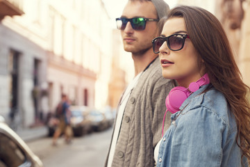 Fashion hipster couple in the street