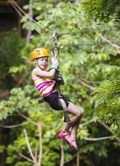 Young girl on a jungle zipline