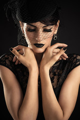 Beauty Fashion Model with Black Makeup with veil