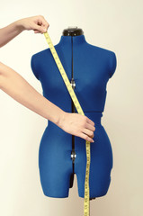 Tailor mannequin with measuring tape isolated, hands, centimeter