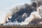 Burning garbage heap of smoke - 64869336