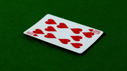 Ten of hearts falling on casino table