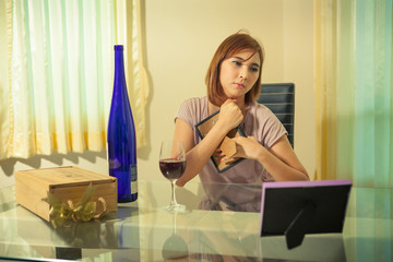 Young woman in depression, drinking alcohol