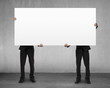 Men lifting blank board