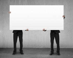 Men lifting blank board