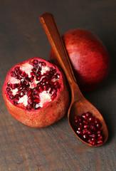 Ripe pomegranates on wooden background